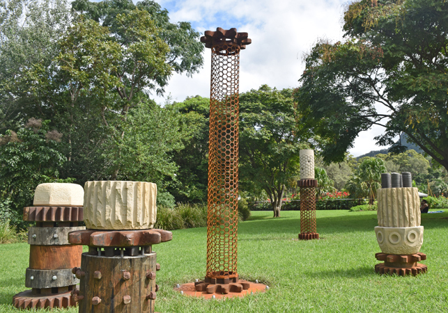Michael Purdy's sculpture 'Steel City' featuring five columns of various heights made from metal, stone and wood