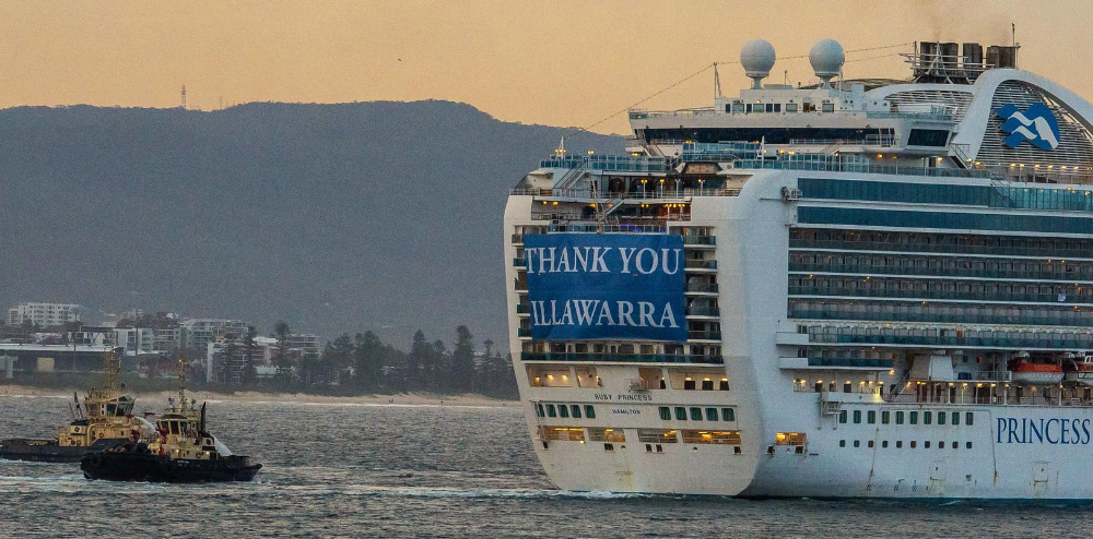 Image of Ruby Princess cruise ship with 'Thank you Illawarra' banner