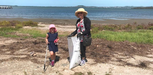 Adult and child on a clean up activity