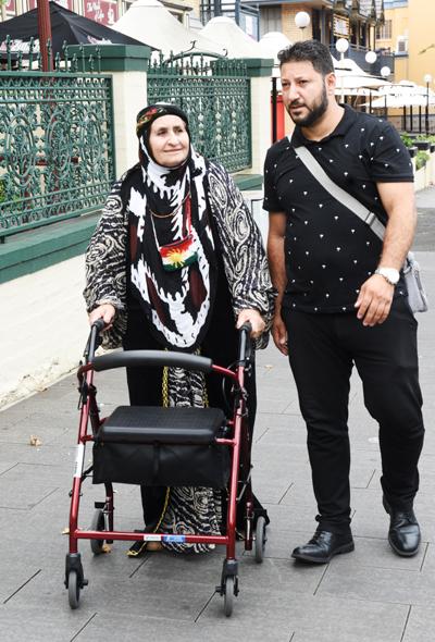 Nura and Manhal walking on a footpath